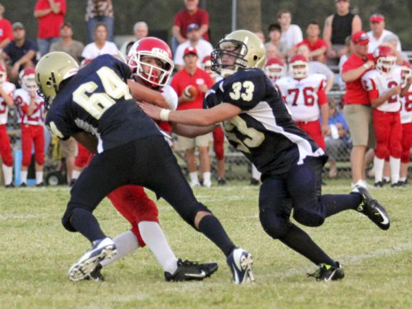 THE PRENTISS HEADLIGHT / #64 Triston Bridges and #33 Steven Colson taking down the Quarterback for Wayne. (Photo by Jennifer Hall, www.photosbyjenny.zenfolio.com)