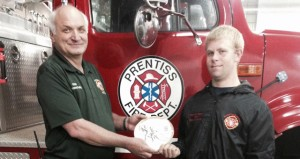 The Prentiss Headlight—Robert Earl Stephens was named Prentiss Fire Department Firefighter of the Year 2014 at their annual banquet recently.  Stephens is being presented the award by Prentiss Fire Chief Howard Kelly.