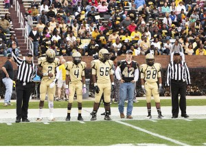 Tony Waits / The Prentiss Headlight—Parker Flowers, brother of the late Loyd Star senior player Peyton Flowers, served as an honorary captain for Bassfield in the state championship game.  The team had a Bassfield jersey made with Peyton's name and number and presented it to the family during the pre-game meal.