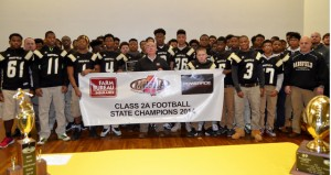 Shirley Burnham / The Prentiss Headlight—BHS Athletes and Coach Lance Mancuso accepted the  2014 Football Championship Banner from  Keith Bridges of Farm Bureau.