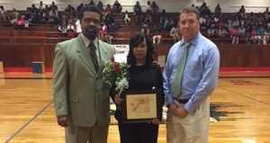Holley Cochran / The Prentiss Headlight—Teffeny Madison being presented Jefferson Davis County Teacher of the Year award by Superintendent Will Russell and Prentiss High Principal Pete Howell.