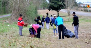 Shirley Burnham / The Prentiss Headlight—Members of the Bassfield High JROTC planted 54 trees along the Longleaf Trace that will benefit Trace users for years to come.