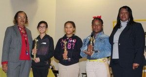 The Prentiss Headlight—JDC Special Projects Coordinator Chellie Payne, first place winner Alexis Tran, second place winner Samora Evans, third place winner Nakhia Arnold, and Federal Programs Director Cammie Reese.