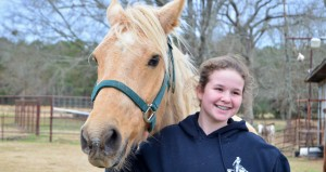 Volunteer Katie Speights helps with the horses and states she has learned much from the Rileys. She works with Shekhanah, a beautiful expert cutting horse who found a new home at the Double AA Ranch & Rescue.