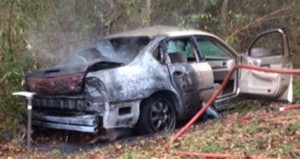 The driver of this Chevy Impala lost control Thursday on the wet curvy roads in Granby. The driver was unconscious when a neighbor who heard the wreck came to his aid. Shortly after the neighbor pulled the driver clear of the accident, the vehicle ignited.