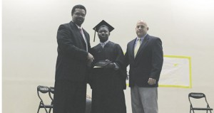 The Prentiss Headlight—Jefferson Davis County Superintendent presenting a high school diploma to Christopher Thompson. Also pictured is Assistant Principal Lance Mancuso.