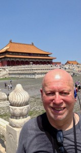 The Prentiss Headlight—Charles Tyrone enjoys traveling. Here he is shown in Beijing in the courtyard of the Forbidden Palace.