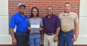 Holley Cochran / The Prentiss Headlight—Logann Thompson has been awarded the Mississippi Association of Supervisors Minority Caucus Scholarship Award. Logann is a 2015 graduate of Bassfield High School and will be entering the University of Southern Mississippi this fall majoring in elementary education. She is the daughter of Debbie Thompson and Terry Arnold. The MAS awards two seniors from each congressional district and two seniors at-large each year.  Winners were chosen based on their written essay about their county and knowledge of county, state and congressional officials. Pictured with Logann are Supervisors John Thompson, Michael Evans and Bobby Rushing.