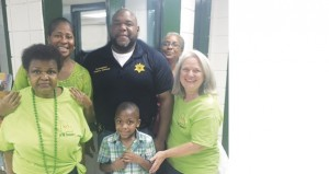 The Prentiss Headlight / Members of Unity in the Community with Mr. Charles Johnson after young Jevelle Monroe pulled Johnson's winning ticket for the $500 cash raffle. The fireworks celebration has been rescheduled to September 5.