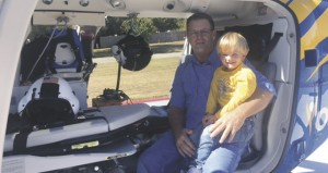 The Prentiss Headlight / Cayson Stamps checks out the new Rescue 7 with his grandad Alderman Randy Stamps.