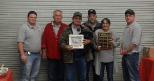 The Prentiss Headlight—Bassfield Volunteer Fire Department Fireman of the Year award is presented to Mark Pittman.