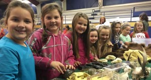 The Prentiss Headlight–First grade girls looking at  pelts and bones.