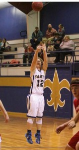 Jenny Hall / The Prentiss Headlight—Blake Greenlee shoots a three for the Saints against Rebul.