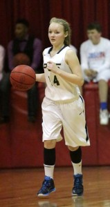 Jenny Hall / The Prentiss Headlight—Josie Hall brings the ball down the court for the JV Lady Saints.