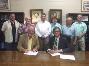 Holley Cochran / The Prentiss Headlight—Mayor Charley Dumas & James Ray Polk sign a lease for the former KLH building at John Street Extension. Polk plans to open Tiny House LIfe Space, LLC., and begin production in the next few months. Also pictured are Aldermen Todd Broome & Willie Davis, Chamber Partnership Director Ben Hamby, Alderwoman Syliva Ward, and Aldermen Keith Bridges & Randy Stamps.