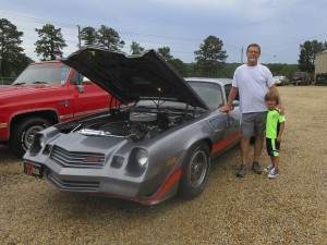 The Prentiss Headlight—Alderman Randy Stamps and grandson Corbin at the car show during the second annual extravaganza. Stamps placed second in the car show's classic category.