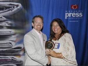 The Prentiss Headlight—Mississippi Press Association President Joel McNeece presenting the first place Editorial Award to The Prentiss Headlight.