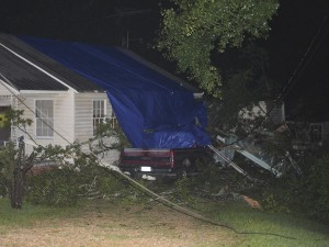 Holley Cochran / The Prentiss Headlight—The home of  Earnie and Debra Langley  on John Street was heavily damaged in a Monday afternoon thunderstorm that left many JDC residents without power for several hours.