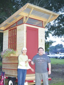 Holley Cochran / The Prentiss Headlight—Randy Broome receives the key to the Tiny House garden shed from Dianna Hutchinson.